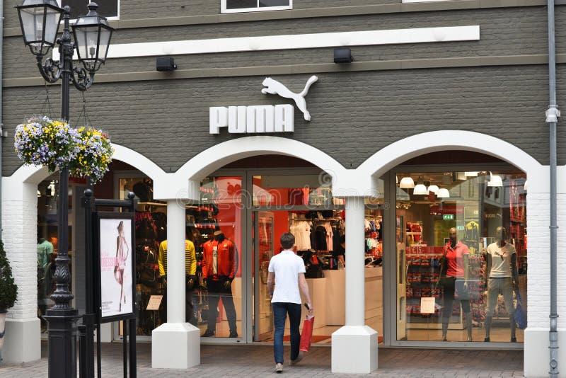 Pumamarkenshop stockbilder