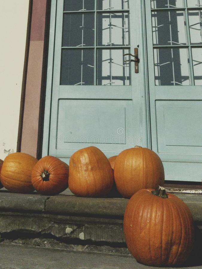 Pumkins and doors. royalty free stock photo