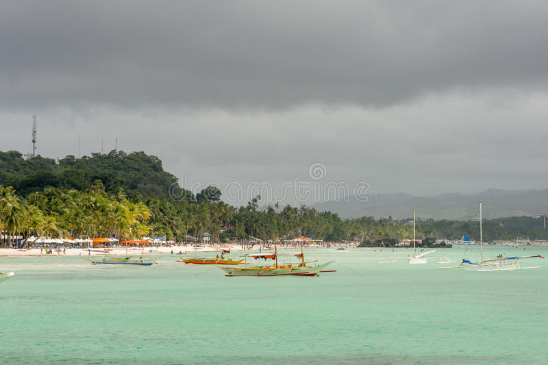 Pump boats float in a turquoise calm sea stock images