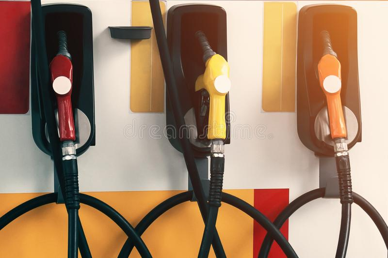 Pump filling nozzles in gas station. Three pump filling nozzles in gas station royalty free stock photos