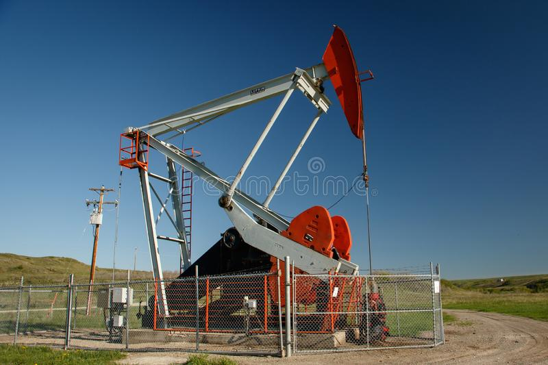 Pump jack on oil field in southern Alberta in Canada stock photo