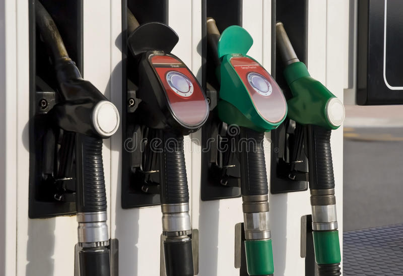 Pump nozzles at the gas station stock image
