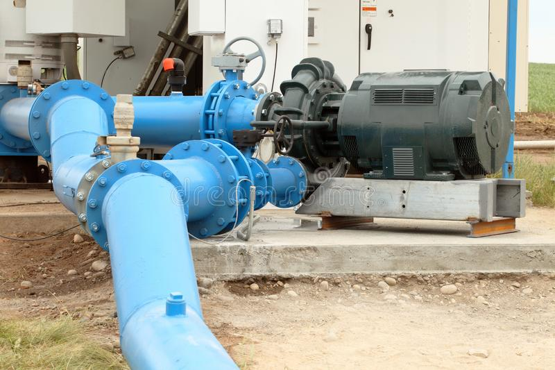 A pump and distribution center for an agricultural sprinkler system. A pump and pipes, make up the distribution center for an agricultural sprinkler system stock images
