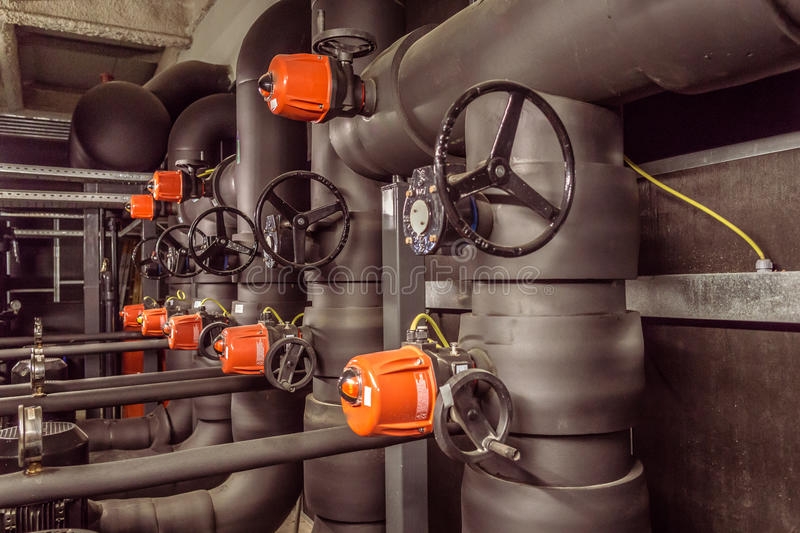 Pump room. In the picture we can see a water pump room with a bunch of valves and cranks stock photo