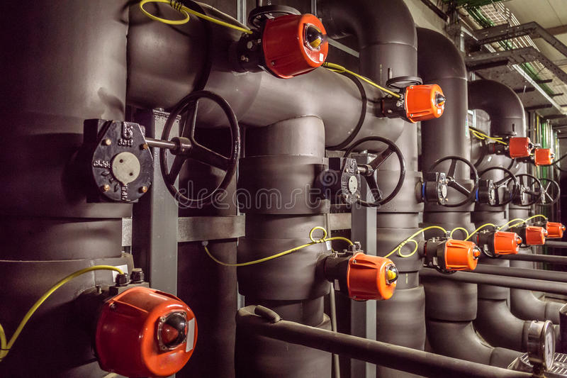 Pump room. In the picture we can see a water pump room with a bunch of valves and cranks royalty free stock images