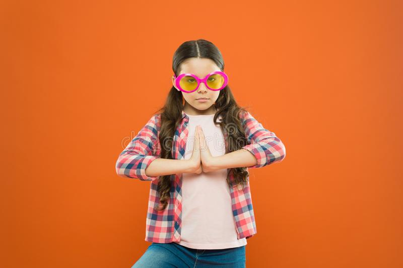 Pump up the volume on your look. Adorable girl with fashion look on orange background. Cute little child having glamour. Look in oversized sunglasses. Vogue royalty free stock photos
