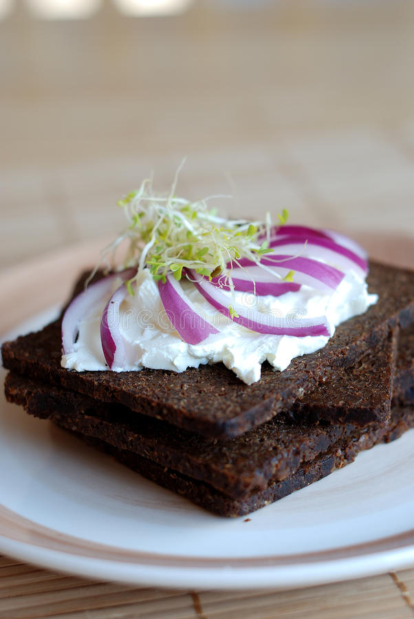 Pumpernickel and cream cheese sandwich royalty free stock photography