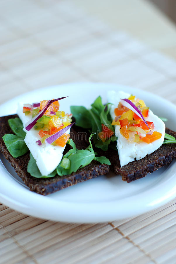 Pumpernickel and haloumi cheese sandwich stock photos