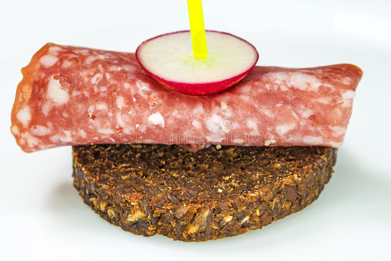 Pumpernickel with salami stock photo