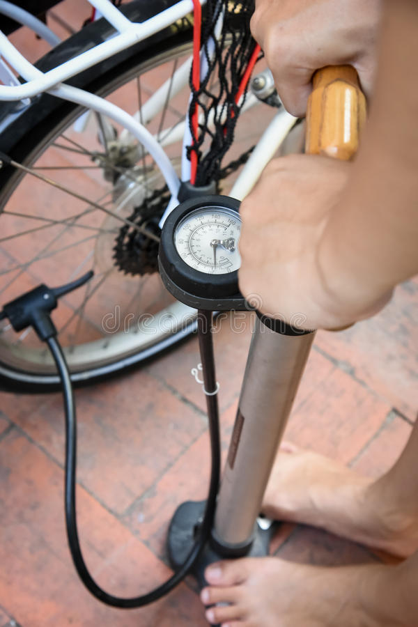 Pumping air to bike tire royalty free stock photo