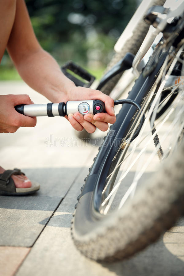 Pumping a bike tire royalty free stock images