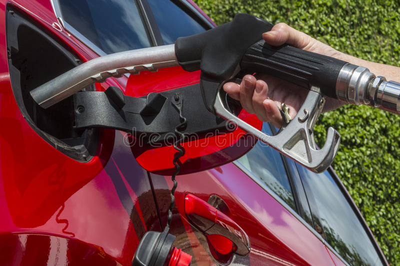 Pumping Gas - Filling a car with fuel. Pumping Gas - Filling a cars fuel tank with diesel or petroleum stock photography