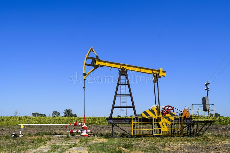Pumping unit as the oil pump installed on a well stock image