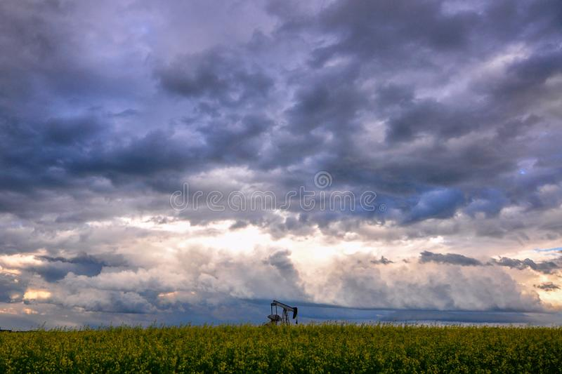 Pumpjack against a dramatic sky stock photo