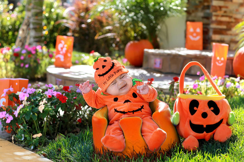 Pumpkin baby. Baby during october on a halloween day royalty free stock images
