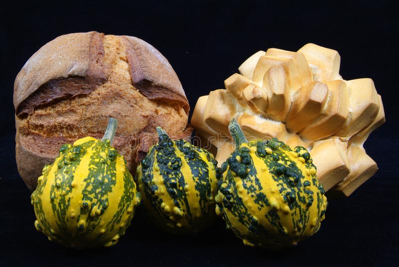 Pumpkin and bread on black background royalty free stock image