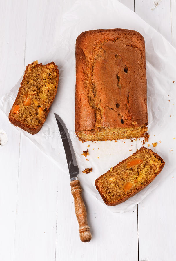 Pumpkin bread loaf over white wooden background stock image