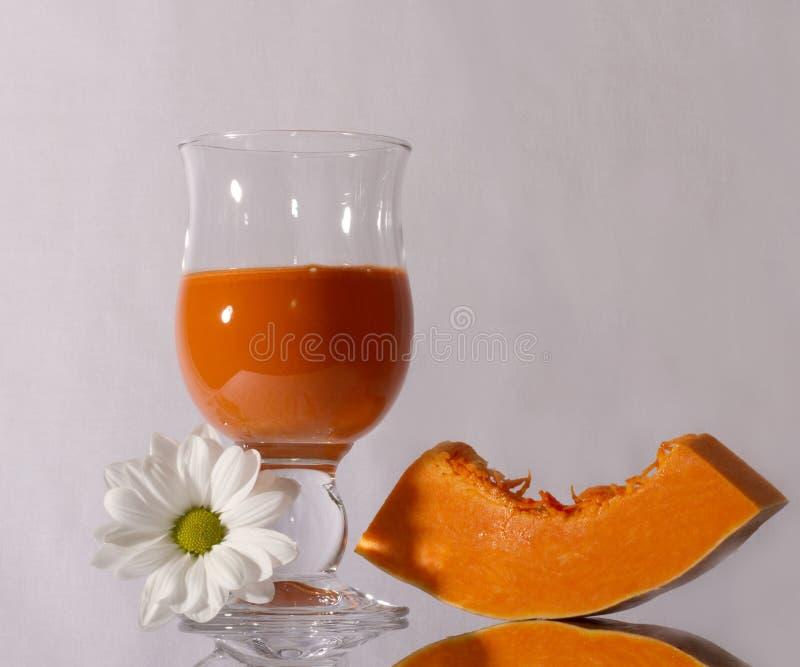 Pumpkin and carrot juice royalty free stock photos