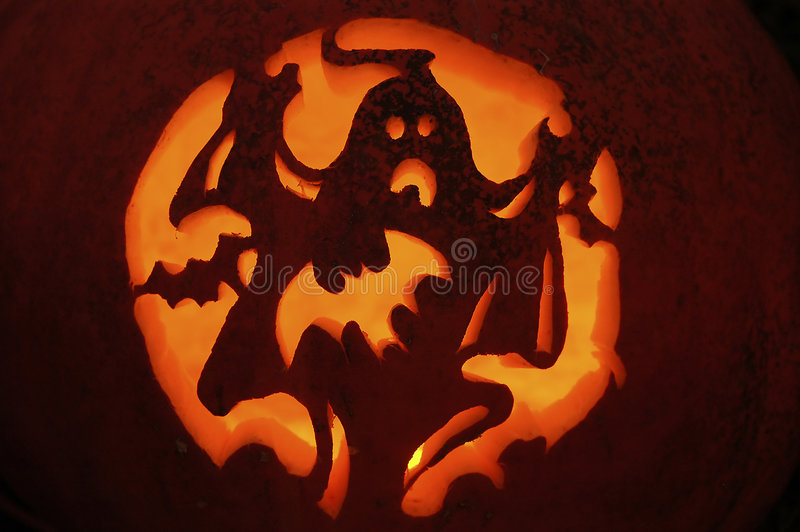 Pumpkin Carving. A ghost with bats pumpkin carving royalty free stock photos