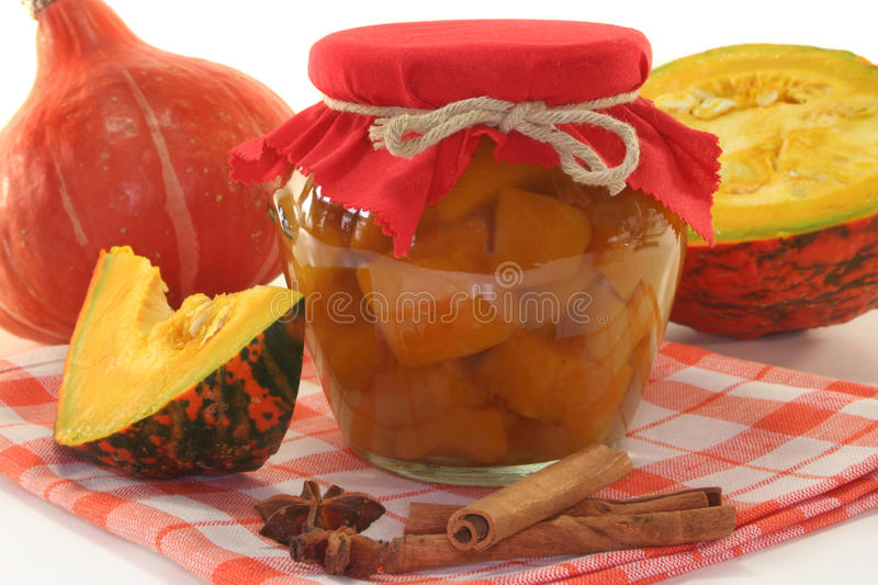 Pumpkin compote. A glass pumpkin compote and fresh ingredients stock photos