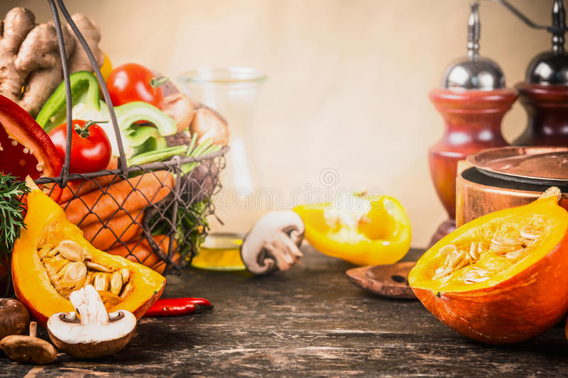 Pumpkin cooking concept. Autumn vegetables preparation on kitchen desk table with pot and ingredients stock images