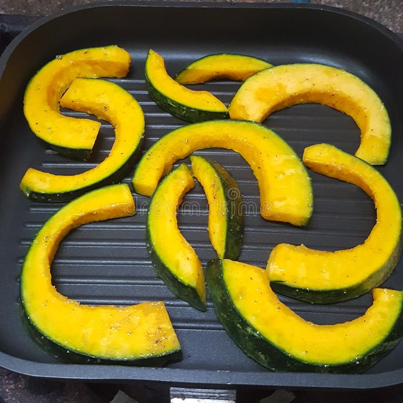 Pumpkin cooking stock photos
