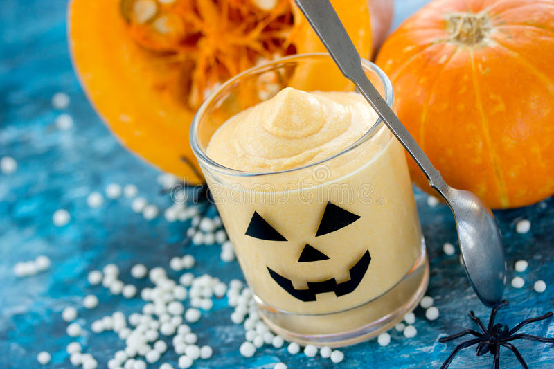 Pumpkin cream, mousse or ice cream for Halloween party, creative royalty free stock images