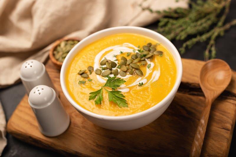 Pumpkin cream soup in bowl stock photo