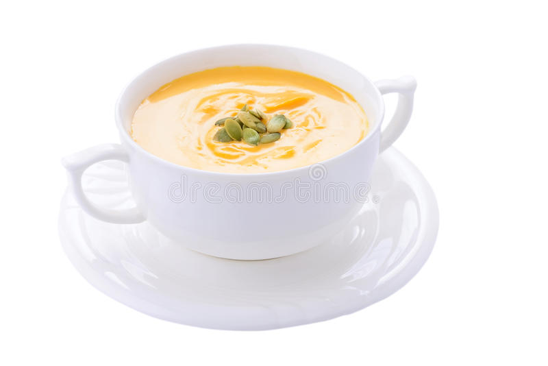 Pumpkin cream soup in bowl on white background stock photos