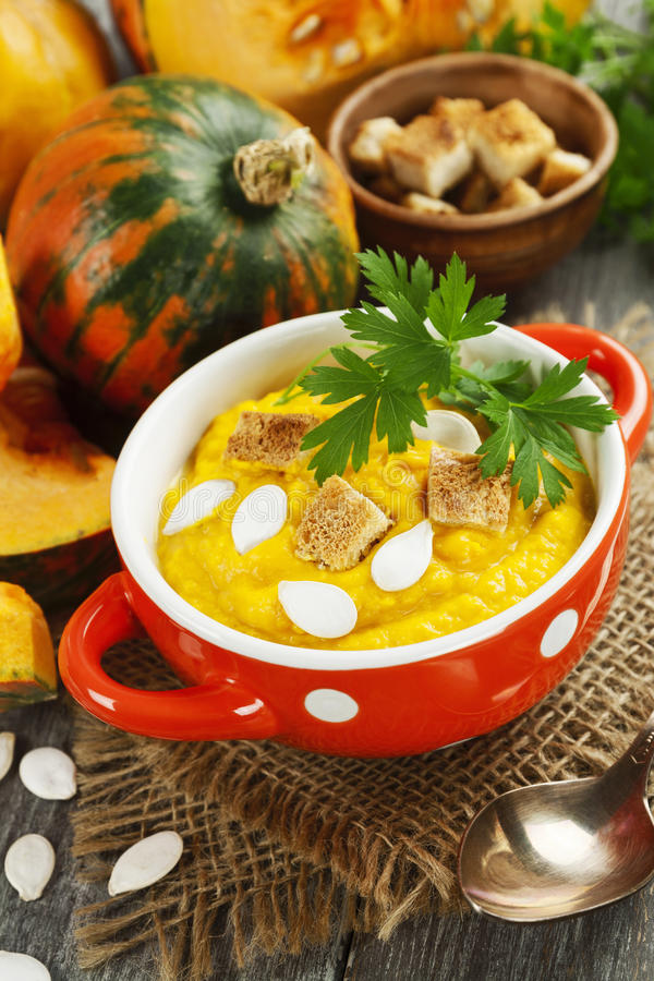 Pumpkin cream soup. And seeds on the rustic table royalty free stock photography