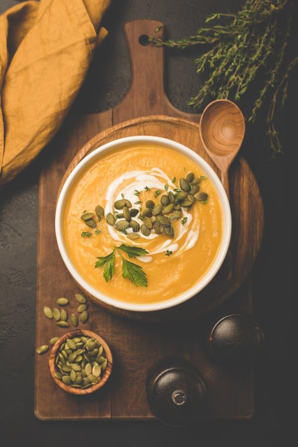 Pumpkin cream soup with pumpkin seeds royalty free stock image