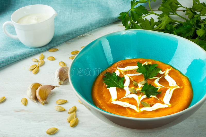Pumpkin creamy vegetable soup royalty free stock photography