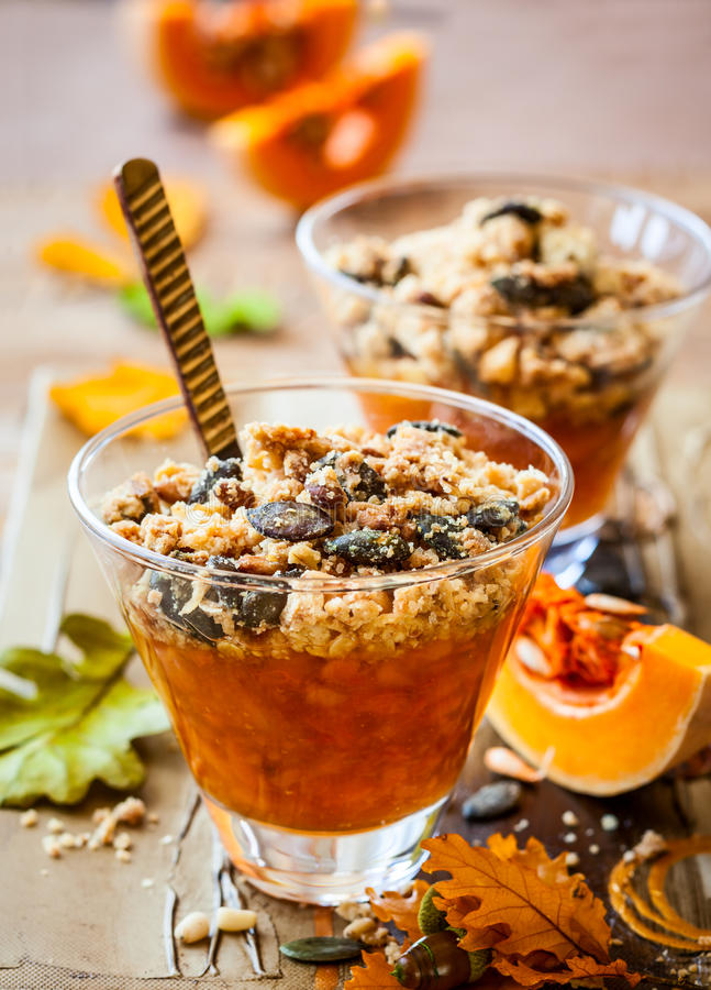 Pumpkin crumble. Sweet pumpkin crumble with pumpkin seeds and pine nut royalty free stock photo