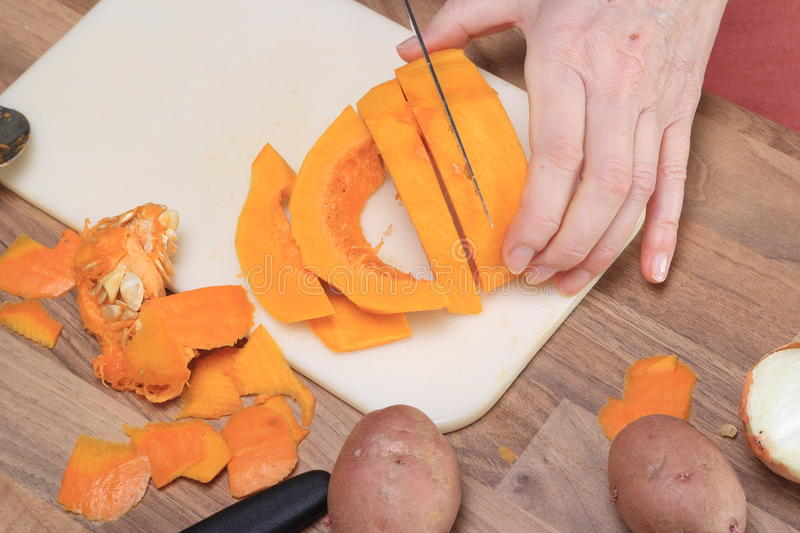 A Pumpkin Is Cut To Slices Royalty Free Stock Photo