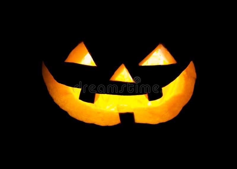 Pumpkin face. Halloween pumpkin face in dark stock images
