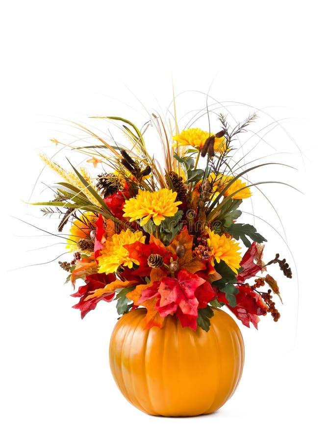 Pumpkin flower arrangement. Beautiful fall flower arrangement with pumpkin vase over white royalty free stock photo