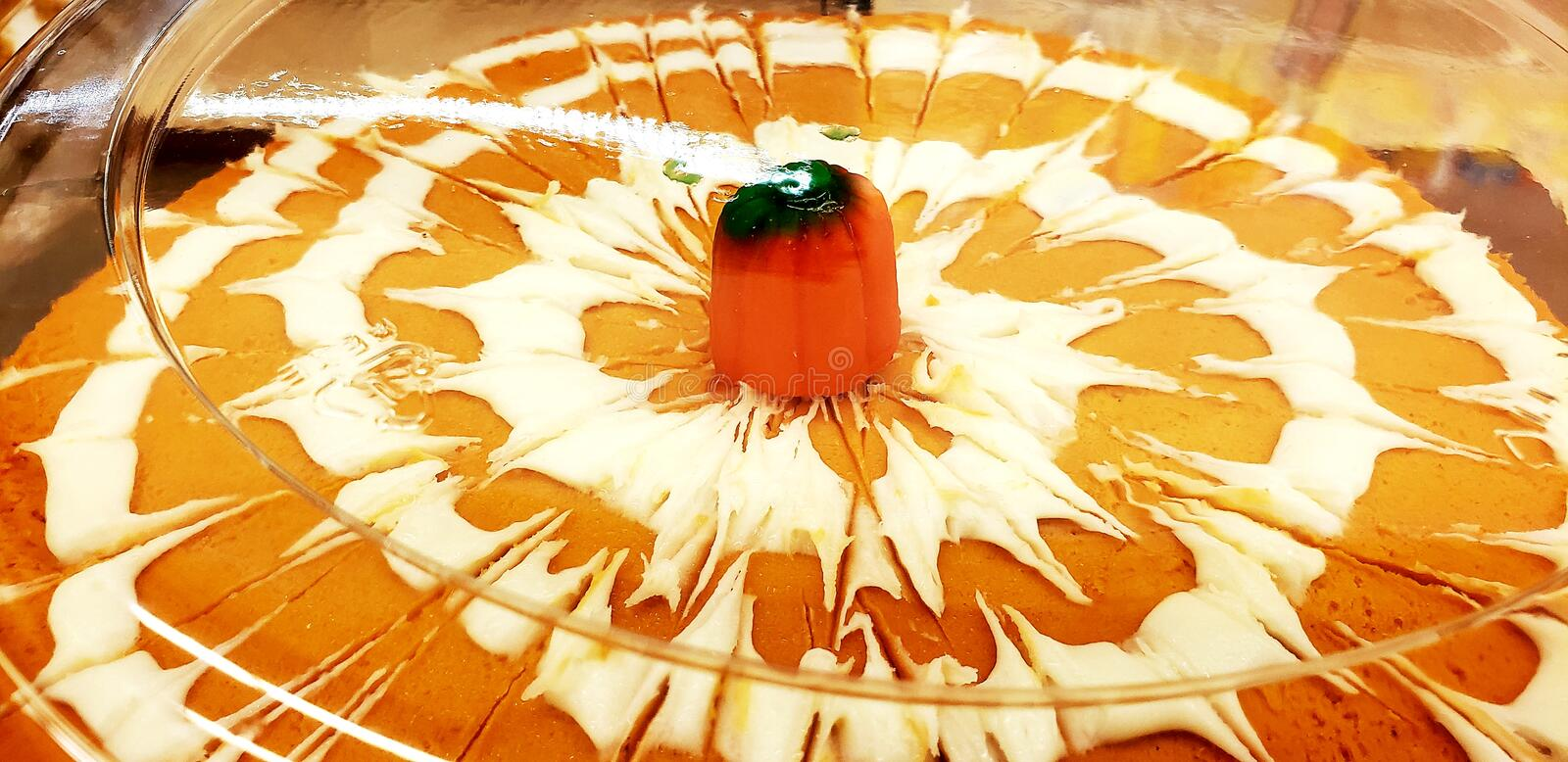 Pumpkin frosted cake in the bakery royalty free stock images