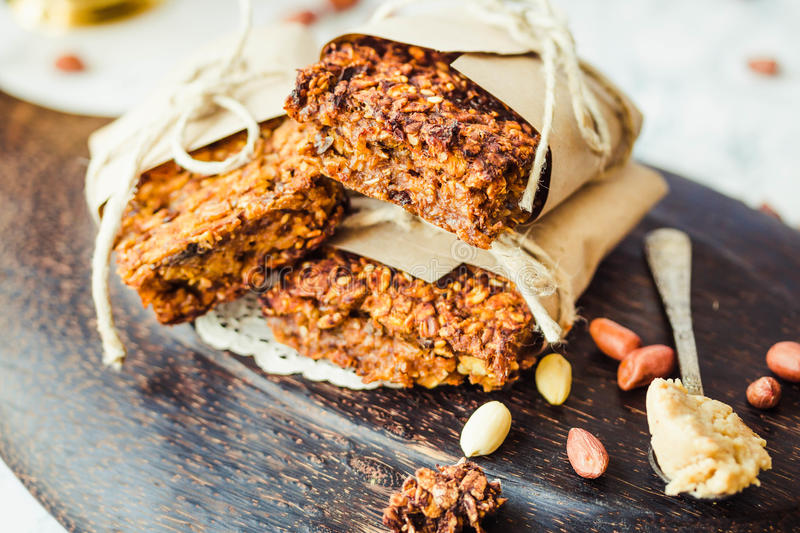 Pumpkin granola bars with peanut butter and seeds. Healthy vegan snack royalty free stock photography
