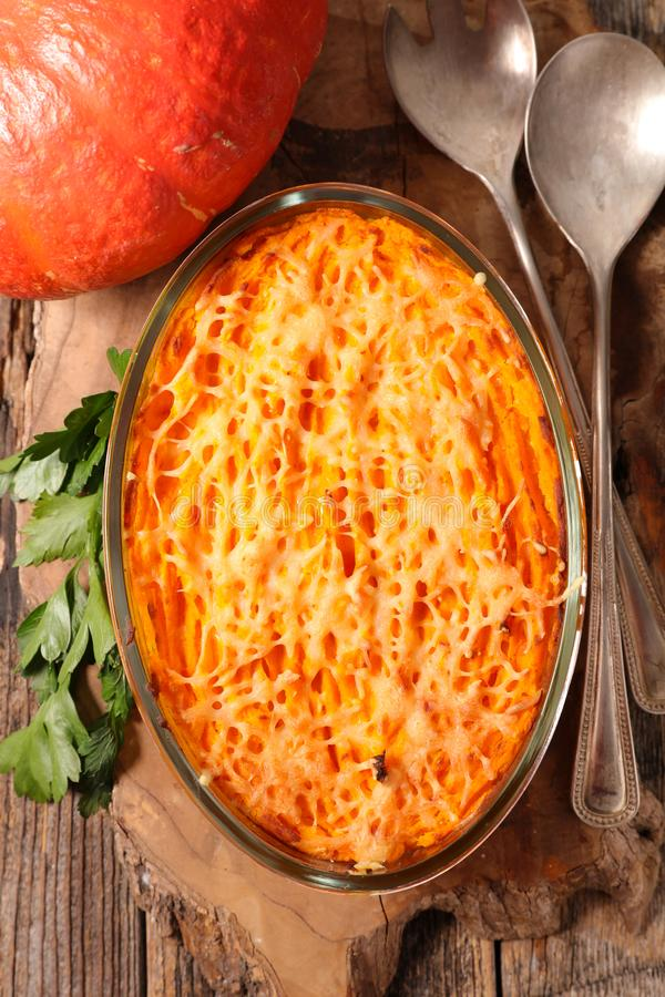 Pumpkin gratin with cheese stock photography