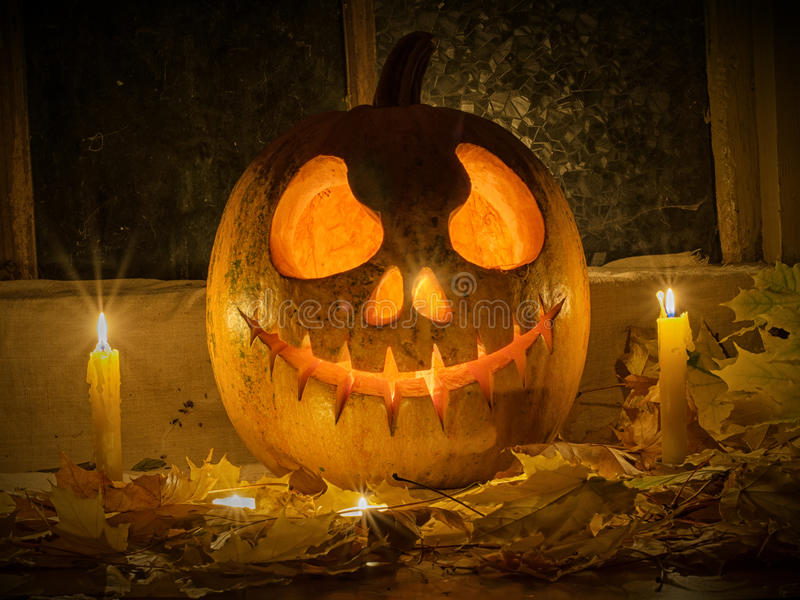 Pumpkin halloween. Photo pumpkins on a table with leaves and candels stock photos