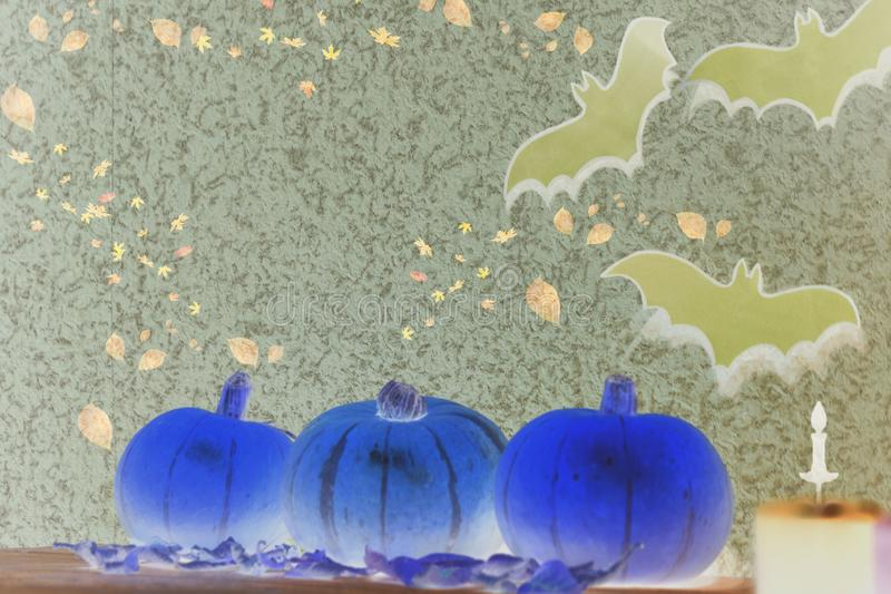 Pumpkin on Halloween on wooden background. Candle, bat. royalty free stock photos