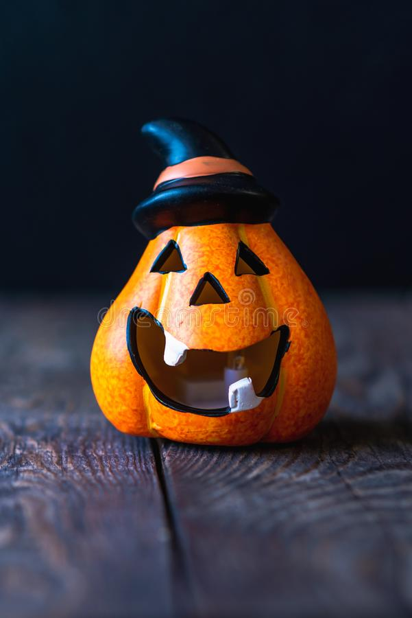 Pumpkin in a hat with a face. Pumpkin in a hat with a cheerful face royalty free stock photo