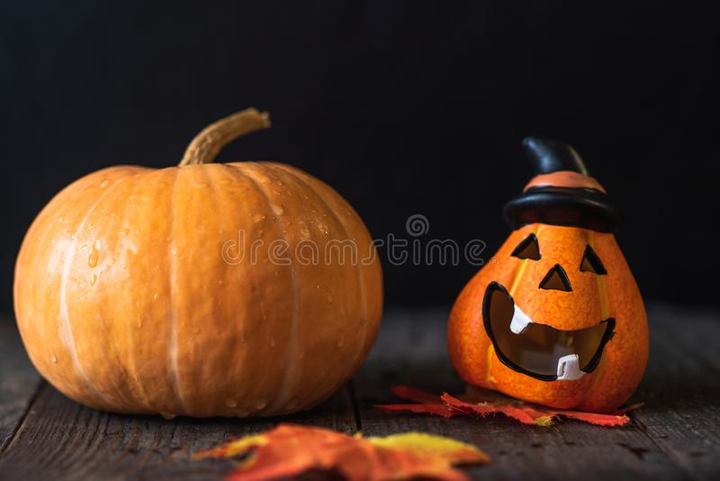 Pumpkin in a hat with a face. Pumpkin in a hat with a cheerful face royalty free stock photos