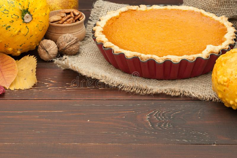 Pumpkin homemade pie at wooden background arranged with food ing stock photo