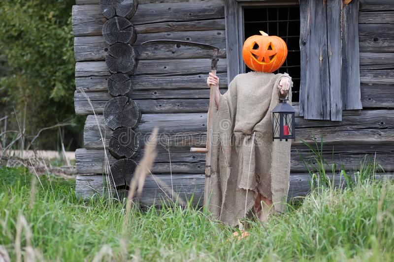 Download Pumpkin Horror Head Monster With A Scythe Stock Image