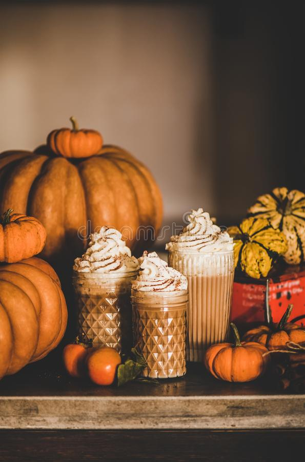 Pumpkin latte coffee drink topped with whipped cream, copy space stock photos