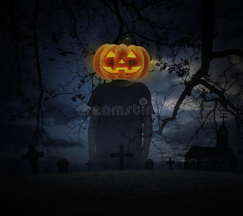 Pumpkin monster head on man body standing over spooky cloudy sky stock images