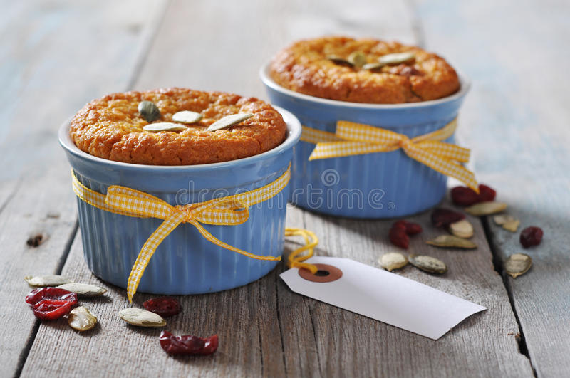 Pumpkin muffins in ceramic baking mold royalty free stock photography