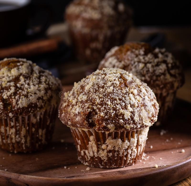 Pumpkin Muffins on a Wooden Plate stock images