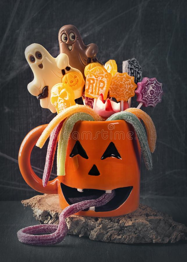 Pumpkin mug with sweets stock photo
